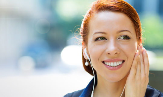 Photo of woman listening to navigation audio