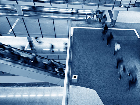 A picture of many people moving through an office building