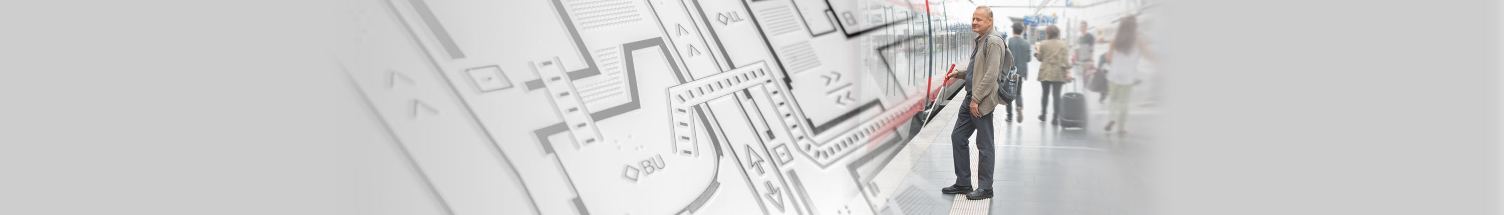 Image of tactile map with attached photo of man with cane standing on subway platform.